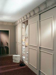 "Sliding doors like this. They slide over in front of the wall space that is the back of the closet half facing the other room. Lots of shelves or cubbies, plus a couple drawers lower down. Put ceiling over adult bedroom, and make a ""crawl space"" loft bed accessible from kids bedroom."