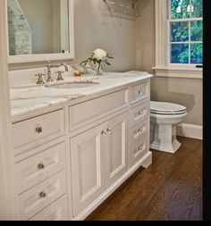 "cabinet ""feet"", toilet w/square base that looks like crown moulding, window sill"