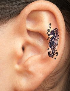 Seahorse ear tattoo - I doubt this is a real seahorse tattoo, but the idea is so good, I myself would even consider it.