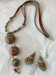 "Polymer clay mandala inspired hollow beads, multicolor suede  leather strap 33"" long necklace and matching earrings."