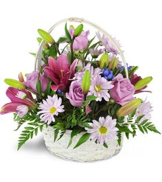 Soothing lavender hues are an ideal gift to send for any quiet occasion.  Show your sympathy or send a loving get-well with this handled basket,  overflowing with blooms.Roses, daisies, lilies, and more are arranged in a whitewashed, handled basket as a lovely expression of your thoughts.