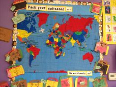 Learning about the world and cultures month bulletin board. The Pre-K's (pretend) travel around the world with their suitcases in hand and map tracker of their travels.