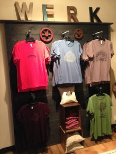 T-shirt display in the studio showing our designs