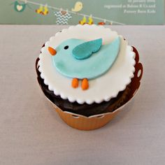 Little Bird fondant cupcake toppers. (photo only) I cut them out by hand then added edible luster dust. The beak and feet and carrot shaped sprinkles, the eye is done with a food marker. These were for a baby shower but they'd be cute for Easter & spring, too.