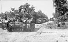 A Cromwell Mk V tank of RTR, Armoured Division, advancing through Cantaloup near Caumont during Operation BLUECOAT, 31 July - 1 August Loyd carriers of Independent Machine Gun Company can be seen in the background. British Army, British Tanks, Royal Marines, Armored Fighting Vehicle, Military Pictures, 1 August, July 1, Ww2 Tanks, D Day