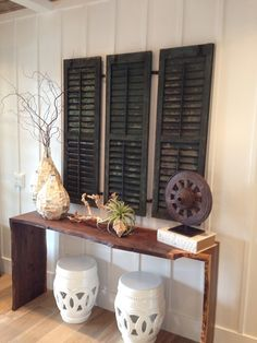 Repurposed shutters give this entryway a shabby chic look.
