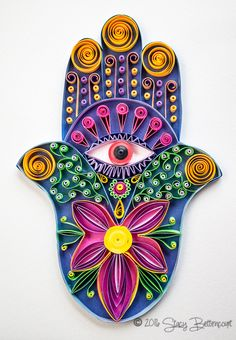 A whimsical and colorful quilled Hamsa Hand by quilling artist Stacy Bettencourt, owner of Mainely Quilling in Jefferson ,Maine.
