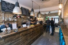 cafe » Retail Design Blog. Love the mood of this space. Polished concrete floors and raw timber counters