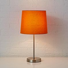 Shop Kids' Lighting: Kids Table Lamp Base with Fabric Shade.  With its understated, easy-to-coordinate style, this orange table lamp shade is exceptionally versatile and just a bit brilliant.