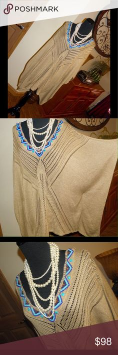 """New Sz L Chico's women poncho sweater Sz L Chico's women poncho sweater.. boho style, beautiful beading, crochet details, tan/gold, V neck.. Slip on style, bat wings wide open sleeves.. New never worn missing tag, has a snag loose stitch pic above nothing major can hardly tell.. Does stretch, bust 21.5"""", length from back of neck to hem 29"""", material 85% acrylic, 13% poly, 2% other City Chic Tops"""