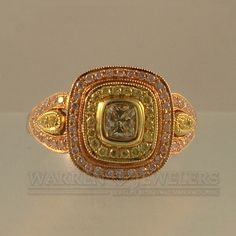 Spectacular combination of yellow and pink diamonds set in a Rose Gold engagement ring or anniversary ring.