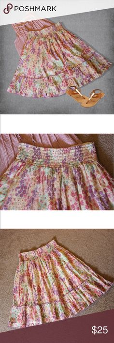 """Floral Flare Anthropologie Skirt I adore this skirt! The purples, pinks, greens, and yellows are perfect for summer! About it:  * Fully lined * 3.5"""" of elasticized waistband * Purple trim * 1"""" of ruffle at bottom * 100% cotton  * Stretchy  MEASUREMENTS:   * Waist 28"""" + elastic * Length 25""""  This skirt is in great condition, by Fei for Anthropologie, and size Medium. Anthropologie Skirts A-Line or Full"""