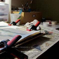 My worktable where I work on my sketchbook projects. The clamps keep the paper from buckling as it gets wet with layers of paint.  Read today's blog: FIVE TIPS TO BUILD MOMENTUM  http://ift.tt/2l7MygF