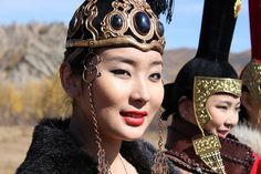 Mongolia....If you are in Mongolia during the National CostumeFestival, this would make the perfect opportunity to witness tsam dancing, traditional folk music and the famous Mongolian throat singing (khoomi). Description from adventurebimbling.com. I searched for this on bing.com/images
