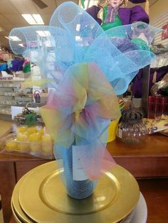 Wine bottle covered in easter colored mesh and ribbon