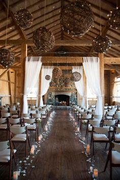 Romantic winter barn wedding with amazing aisle and lighting