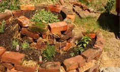 Raised Spiral Garden Bed  * Lay down a thin bed of compost.  * Lay down some cardboard.  * Set down your bricks in a spiral formation.  * Add layers of bricks to your spiral until it's as tall as you want or you run out of bricks.  * Build your layers inside the bed: fill 1/3 with rocks, the rest of the way with straw, top with compost, add plants, then top with potting soil.