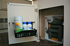 Pop Up Camper Remodel:  Adding More Storage.  A Rubbermaid Command storage basket on a cabinet door makes the perfect place to store cleaning chemicals.