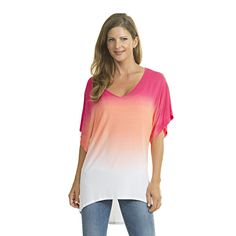 A dip dye kimono tunic from Luna West reflects brings out a trendy vibe. The ombre fuchsia white dolman short sleeved top has a slightly V neck shaped neckline. You can team this versatile piece with various pants for fashionable outfits.