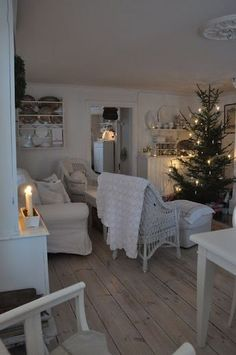 Vita Verandan~ simple simple , minimal colour, shabby chic, farmhouse, country living style , like my home without the colour , gives you an idea of a way to fit a christmes tree into your normal room design and layout