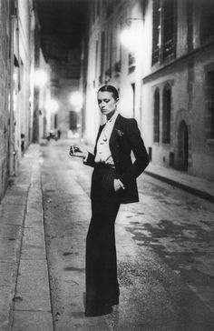 """Le Smoking"" tuxedo for women by Yves Saint Laurent. Designed in 1966. Photo taken by Helmut Newton in 1975"