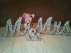 Mr & Mrs sign / Silver Glitter wedding decor. $50.00, via Etsy.