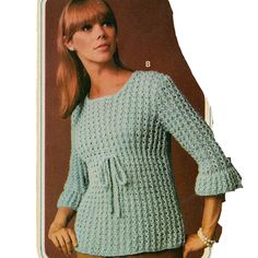 Knit Empire Blouse Pattern.  This attractive Knitted Blouse has the high Empire Waist with a dividing tie. It also has a rounded neckline and flared three quarter length sleeves.