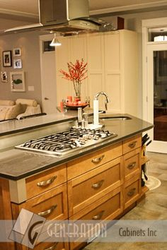 Another Look At This Gorgeous, Functional Island With A Stove Top And  Central Hood Vent