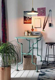 Rustic Pipe Table - Urban Outfitters...maybe a dining room table. Something lifted with a direct light