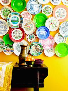 Mismatched plates are easy to find at flea markets and garage sales. Gather a collection of dishes in different sizes, themes, and colors, and group them on the wall for an interesting display