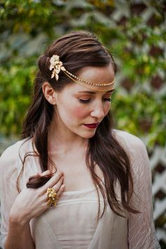Rhinestone and chain headpiece with brass flower pins, style 505. $85.00, via Etsy.