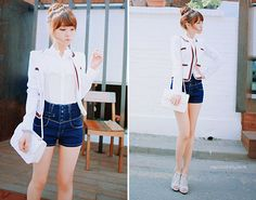 Blue Hipster buttoned up shorts, button down shirt, white and velvet red jacket with stiletto shoes.