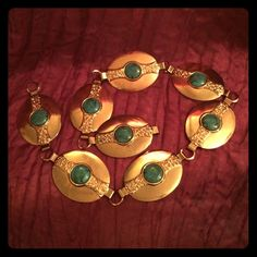 """True vintage 1970s concho turquoise belt Full length is 25 inches. 8 Concho oval alloy disks with faux turquoise stone Centers . Each disk link is 3"""" X 1.75""""  total weight is 3.13 oz there is no hallmark or brand but the item dating is approx 1972-1976 Purchased at an estate auction where the other items in this collection being of similar composite and style sold for an average of $781.33 with a top of 3k and a low of $89 if you have more info on this item please share it in the comments. I…"""