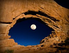 THE EYE OF THE MOON - This perfectly timed photograph looks like an eye. You can see the moon through the North Window arch at Arches National Park in Utah. The park is located in Eastern Utah and is known for preserving over natural sandstone arches. All Nature, Amazing Nature, Nature View, Nature Images, Nature Photos, Beautiful Moon, Beautiful Places, Simply Beautiful, Cool Pictures