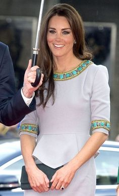 Kate Middleton-Gray peplum dress with zippered back. Gold & Jade Jewel encrusted sleeves and neckline. Not her best look.