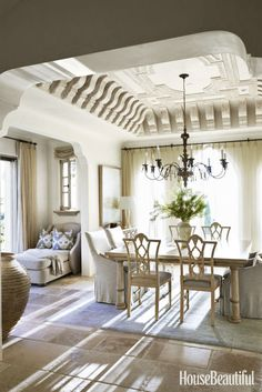 The breakfast room doubles as a place to work a big, square, custom-made table and armchairs.
