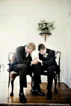 The groom and the best man praying right before he walks to the alter...wow. Nothing would melt my heart more than to get my wedding pictures back and see this among them. <3