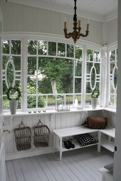 Four Season Porch - welcoming entryway with beautiful windows, painted floors and painted white interior walls and bench. Benches and wall hooks hung low work around the lack of wall space - via Lilla Villa Vita Style At Home, Enclosed Porches, Windows And Doors, Porch Windows, Cottage Windows, Home Fashion, Cabana, Cottage Style, My Dream Home