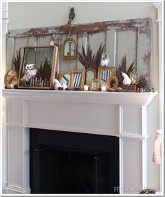 fall mantel w/feathers. LOVE the small mirror/layered w/old key, hanging from the bill hook