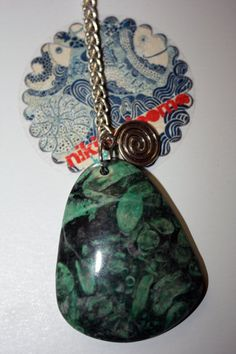 Emerald green coral fossil pendant with beautiful silver charms <3
