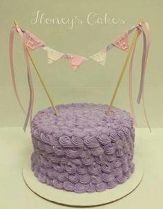 Pretty lilac buttercream rosette baby shower cake from Honey's Cakes.  www.honeyscakes.com