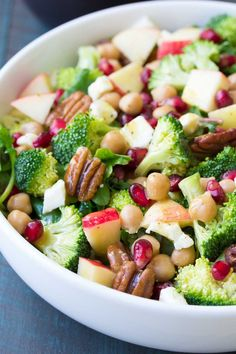 This Broccoli Kale Superfood Salad is a healthy holiday side dish. It's also delicious for lunch! With chickpeas, pomegranate seeds, apple, pecans and feta cheese.  A favorite no mayo broccoli salad! #sponsored