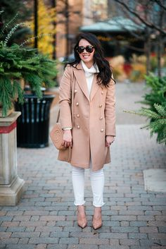 Camel coat and white sweater