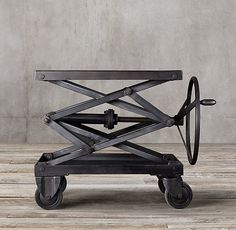 Restoration Hardware - Industrial Scissor Lift Table. An amazingly sturdy thing.  Very heavy, and conveniently capable of being used as a standing work surface when teleworking.  Right now it's been relegated to an end table in the living room.