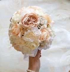I love the gentle blending of champagne pink peonies, carnations, and ivory and beige roses in this beautiful bouquet. The effect is elegant and tasteful - a perfect addition to your bridal flowers.  The bouquet measures approximately 9 inches across and the handle is wrapped in white satin, finished with pretty pearl beading.  ** The colours will fit perfectly with a rustic chic / country chic themed wedding.  ** Looking for a toss / throw bouquet, to save your gorgeous bridal flow...