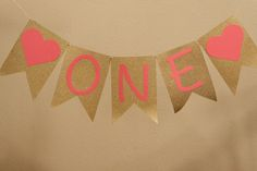 """Pink and Gold """"One"""" banner. For 1st birthday birthday party. Hang on wall, highchair, use in photo shoot."""