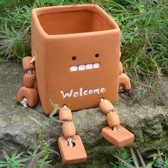 A robot boy (gardening, gardening, planter cover)