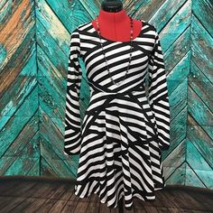 """NWOT. Geometric Striped Fit & Flare dress Flattering fit & flare dress.  Fits a little smaller than a true medium. Material does stretch. Shoulder to hem-31"""".  Classic black & white.  Very comfortable and stylish! Joseph Q Dresses"""