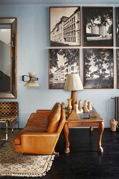 dark floor, great leather couch, excellent legs on the table and blue wall