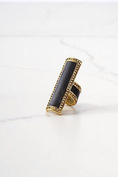 Helicon statement ring   Black leather accents   Gold studded trim   Measures approximately 2 in length  Imported Helicon Statement Ring by House of Harlow 1960. Accessories - Jewelry - Rings Mexico